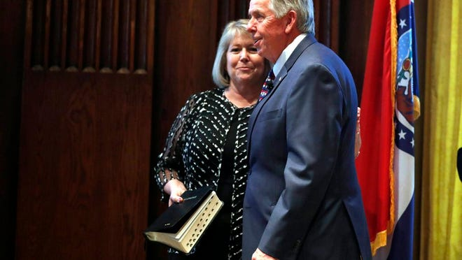 FILE - In this June 1, 2018 file photo, Gov. Mike Parson, right, smiles along side his wife, Teresa, after being sworn in as Missouri's 57th governor in Jefferson City, Mo. Teresa Parson has tested positive for the coronavirus after experiencing mild symptoms, a spokeswoman for the governor said Wednesday, Sept. 23, 2020.