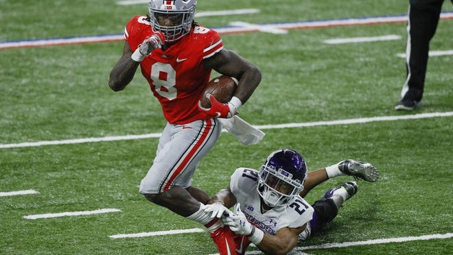 Trey Sermon rushed for a record 331 yards in the Buckeyes' victory over Northwestern in the Big Ten Championship on Saturday.