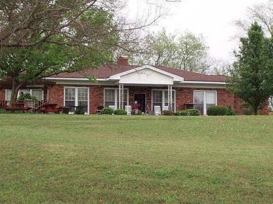 A home sits on a portion of the property at 2516 Buena Vista Pike where the apartment project was planned.
