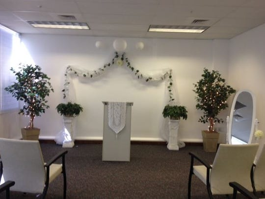 Matrimonial room at Lee County Courthouse is a busy place on Valentine's Day.