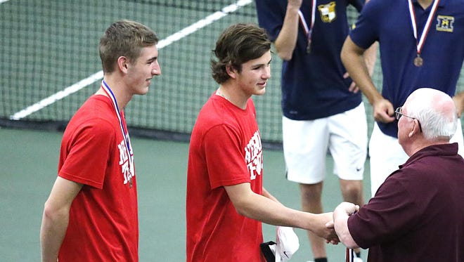 Grant Mauthe and Carter Brown of Neenah receive their award for finishing third in Division 1 doubles at the WIAA state meet Saturday in Madison.