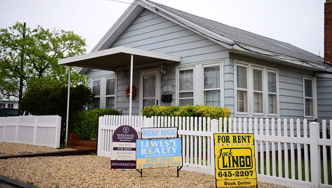 A home on Savannah Road in Lewes has multiple signs advertising rentals on Tuesday, April 25, 2017.