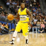 Robinson averaged 5.8 points in 38 games with the Nuggets this season.