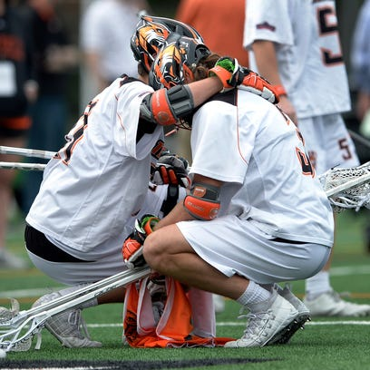 RIT's Trevor Smyth, left, hugs Eli Salama after their