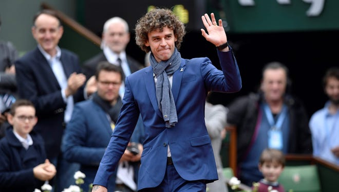 Gustavo Kuerten, 39, won the French Open in 1997, 2000 and 2001.