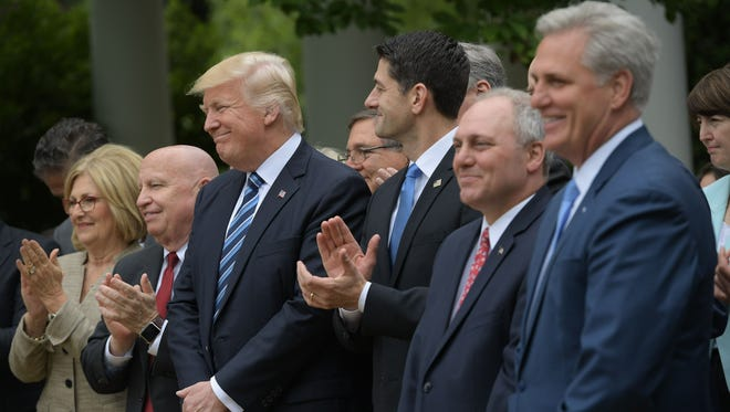 President Trump, Speaker Paul Ryan and other congressional Republicans celebrate in the Rose Garden of the White House following the House vote to repeal Obamacare on May 4, 2017.