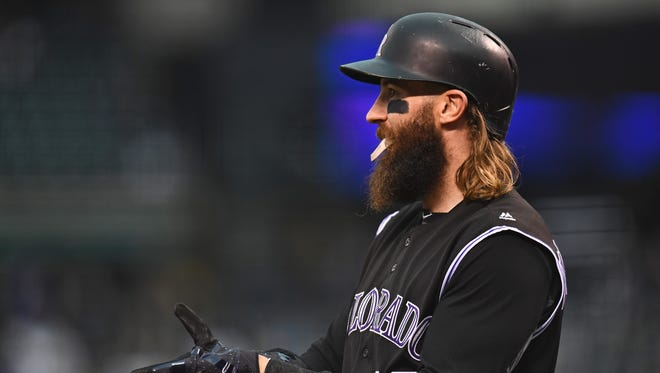 Colorado Rockies center fielder Charlie Blackmon (19) on deck in the first inning against the Los Angeles Dodgers at Coors Field.
