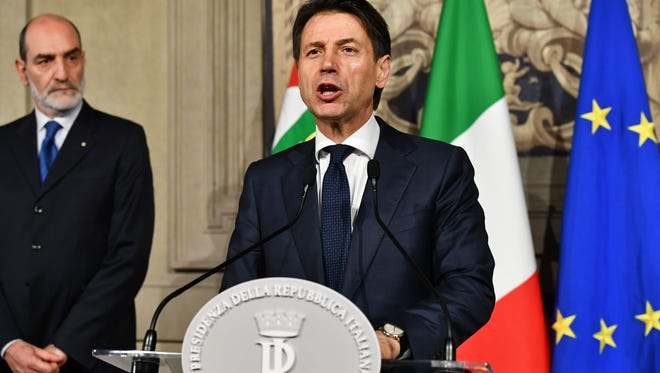 Italy's prime minister candidate, Giuseppe Conte, addresses journalists after a meeting with Italian President Sergio Mattarella on May 27, 2018 at the presidential palace in Rome. Conte gave up his mandate to form a government after talks with the president collapsed.
