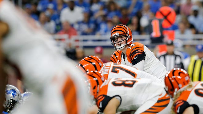 Cincinnati Bengals quarterback Andy Dalton (14) looks down the line before a play in the second quarter of the NFL preseason game between the Detroit Lions and the Cincinnati Bengals at Ford Field in downtown Detroit on Thursday, Aug. 18, 2016.