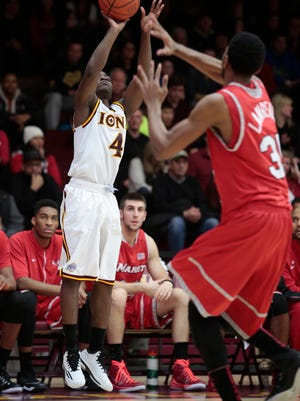 Iona's Schadrac Casimir shoots a 3-pointer in the first half Sunday against Marist at Iona College in New Rochelle. Iona won 89-67.