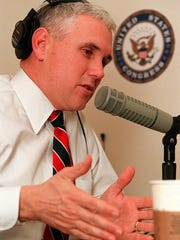 Rep. Mike Pence R-Ind. speaks during his radio talk show in his Capitol Hill office Monday March 26 2001 in Washington. Pence believes he is the first House member to create a radio studio in his congressional office. (GNS Photo by Mario Tama)