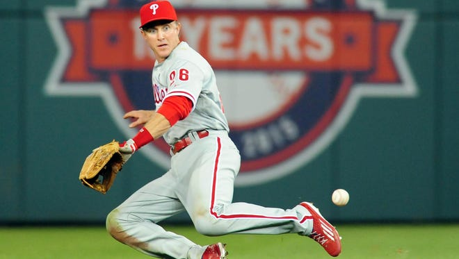 Phillies second baseman Chase Utley fields a ground ball Friday in the seventh inning against the Washington Nationals at Nationals Park.
