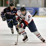 Great Falls Americans' Blake Miller (7) controls the puck against Billings Bulls' Bryce Jensen Sunday at the IcePlex.