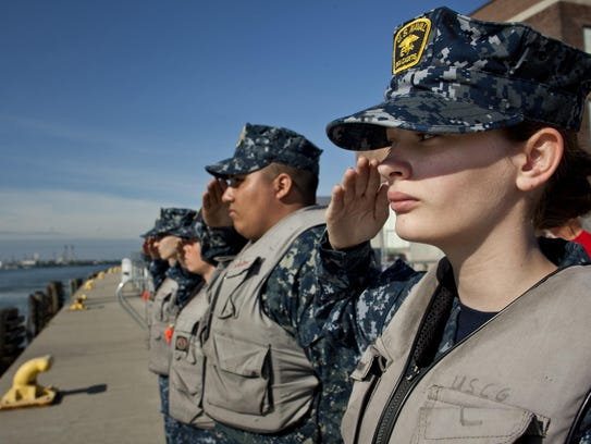 U.S. Naval Sea Cadet Emily Hendricks, 14, salutes retired