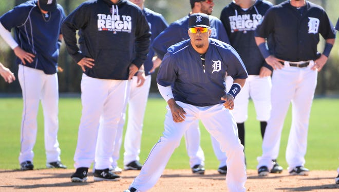 Victor Martinez and the Tigers do base running drills at spring training.