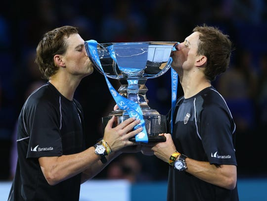Bob and Mike Bryan of the United States lift the ATP