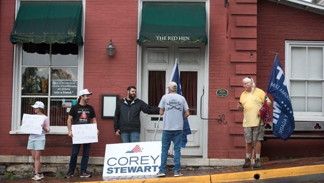 Trump supporters stand outside of the Red Hen June 26 after Sarah Huckabee Sanders was unceremoniously evicted from the Virginia restaurant.
