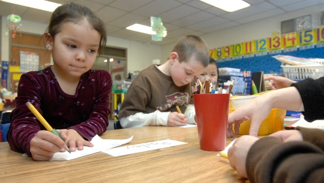 A new program, Achievement Gap Reduction, would continue to allow schools to earn aid to help keep class sizes small for low-income students.
