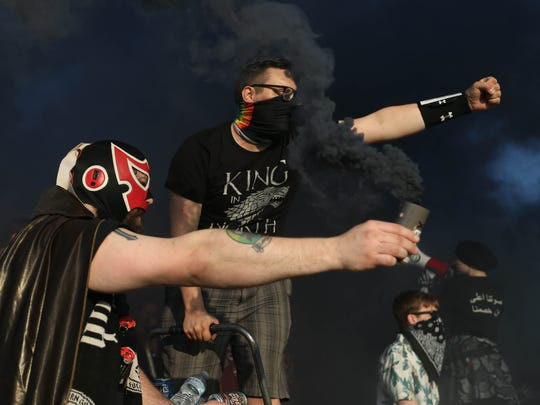Detroit City FC fans pop smoke during the game against