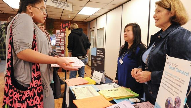 From left, Reedsville High School junior Alexis Schultz asks questions about different careers opportunities with Choua Lee and Judy Stanton, both educational services specialists/academic advisors from Lakeshore Technical College during the Career Fair at Lakeshore Technical College Cleveland Campus on Thursday. More than thousand area high school students explored future career interests by talking to recruiters from area businesses and colleges. Sue Pischke/HTR Media. Photo taken on Thursday, Jan 9, 2014