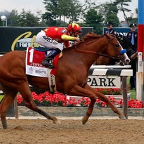 Justify goes wire to wire in Belmont Stakes to win Triple Crown