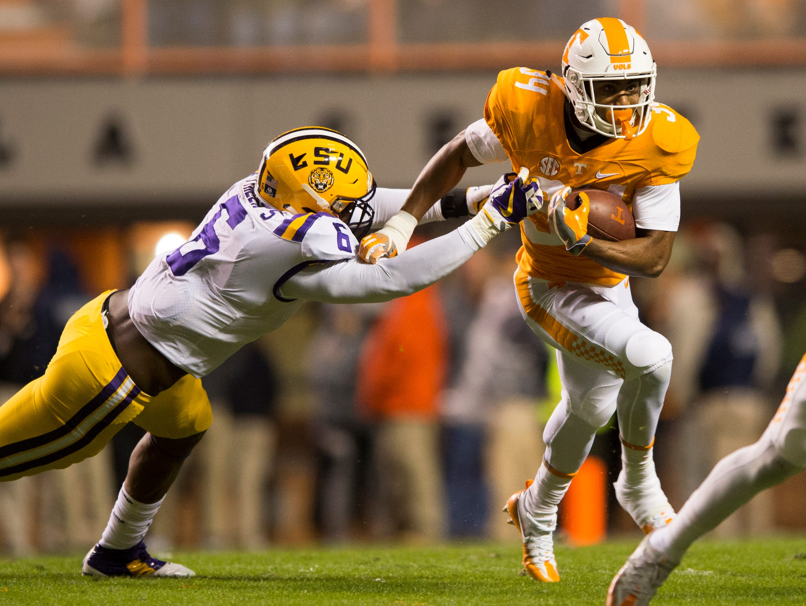 Tennessee's Malik Elion (34) escapes a tackle by LSU linebacker Jacob Phillips (6) during a game between Tennessee and LSU at Neyland Stadium in Knoxville, Tenn., on Saturday, Nov. 18, 2017.