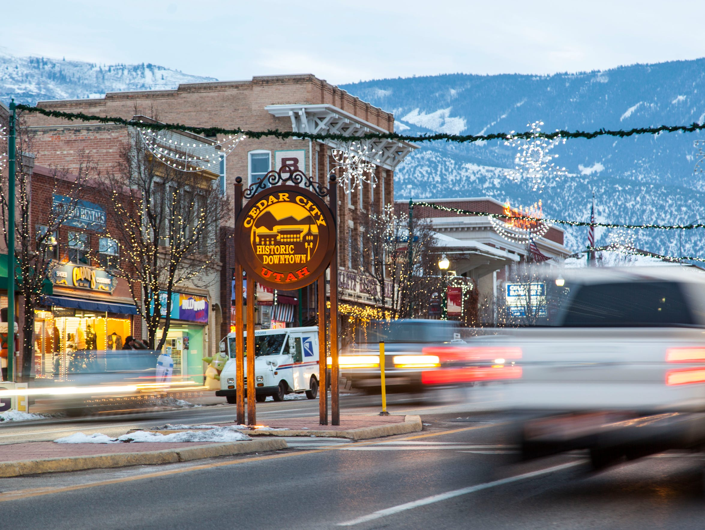 Traffic passes through Cedar City on Main Street.