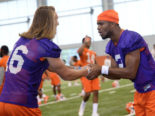 Clemson quarterback Trevor Lawrence (16) and quarterback