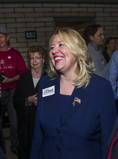 Debbie Lesko chats with supporters Stacey Meier (left) and Gilbert Wong  at her campaign gathering at home in Peoria on Feb. 27, 2018. Lesko pulled out to an early lead in the special primary election.