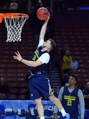 Marquette Golden Eagles guard Andrew Rowsey dunks the ball during practice for the first round of the NCAA Tournament at Bon Secours Wellness Arena.