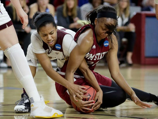 Arizona State guard Arnecia Hawkins, left, and New Mexico State forward Brianna Freeman battle for the ball during the first half of a first-round women's college basketball game in the NCAA Tournament, Friday.