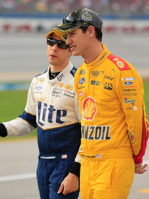 Team Penske's Brad Keselowski, left, and Joey Logano, right, have combined to win four of the past five races at Talladega Superspeedway.