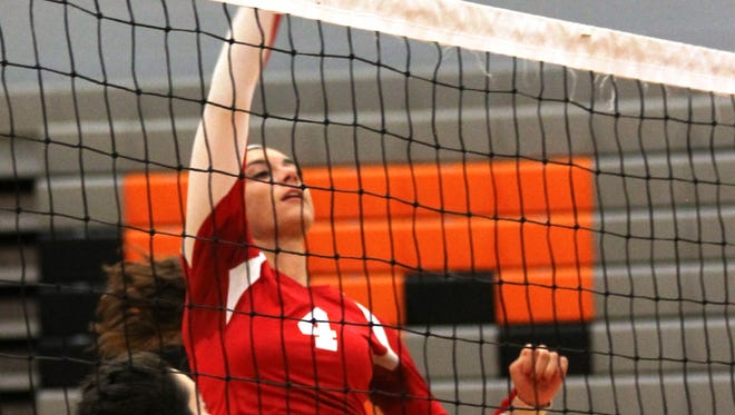 Milford High School senior hitter Lauren Moeller (4) registers a kill against Withrow in a straight-sets volleyball road win over the Tigers Aug. 26.