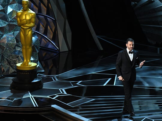 Host Jimmy Kimmel gives a shoutout to the Oscar statue
