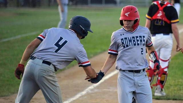 Kyler Watson, right, and the rest of the junior class has helped the Ballard baseball team look strong in its first two games. The seventh-ranked Bombers whipped Adel-Desoto-Minburn in their opener and won at Nevada Tuesday. Photo by Joe Randleman/Ames Tribune