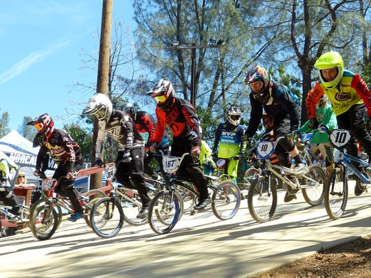 Riders begin a practice race before a BMX tournament at Shasta Lake's Boomtown BMX track Sunday.