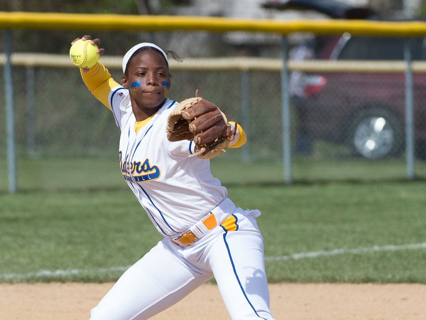Caesar Rodney's Rosa'lynn Burton (5) with a throw to first base in their game against Concord.