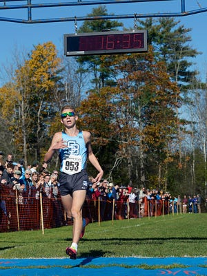 Lucas Calcagni of South Burlington crosses the finish line to win the Division I title at the Vermont Cross Country Championships at Thetford Academy on Saturday, Oct. 28. (Photo by Paul Hayes)