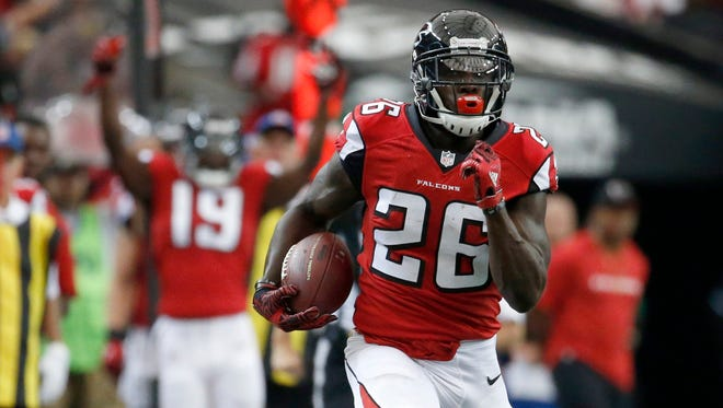 Sep 11, 2016; Atlanta, GA, USA; Atlanta Falcons running back Tevin Coleman (26) carries the ball in the third quarter of their game against the Tampa Bay Buccaneers at the Georgia Dome. The Buccaneers won 31-24.