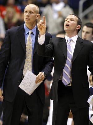 Former Xavier assistant coach Pat Kelsey (right), now the head coach at Winthrop, knows he can count on his dad, Mike Kelsey, to be there during the tough times.