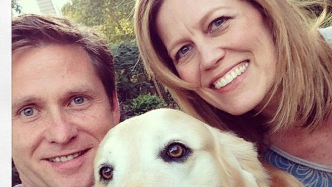 Mark Gerardot poses with his wife, Jennair Gerardot and their Labrador in a photo posted to Mark's Instagram account.