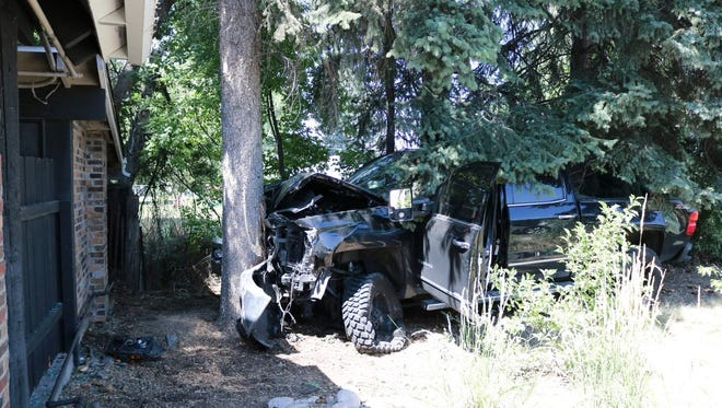 A black pickup truck hit a power box, two cars and a tree in a Fort Collins crash at a business' parking lot off Harmony and Timberline roads on Wednesday, July 11, 2018.