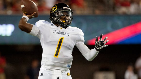 Grambling State Tigers quarterback DeVante Kincade (1) passes the ball against the Arizona Wildcats during the first half at Arizona Stadium. Mandatory Credit: