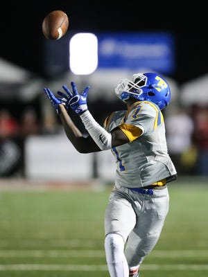 Tupelo High School's Jordan Jernigan (1) hauls in a pass in the third quarter. Brandon and Tupelo played in an MHSAA Class 6A football game on Friday, September 8, 2017 at Brandon. Photo by Keith Warren