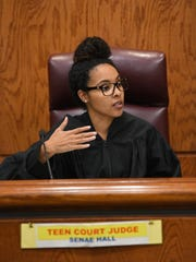 Judge Senae Hall asks the defendant questions in teen