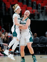 UWGB guard Allie LeClaire, left, celebrates hitting a 3-pointer with Caitlyn Hibner against Wright State in the Horizon League championship game.