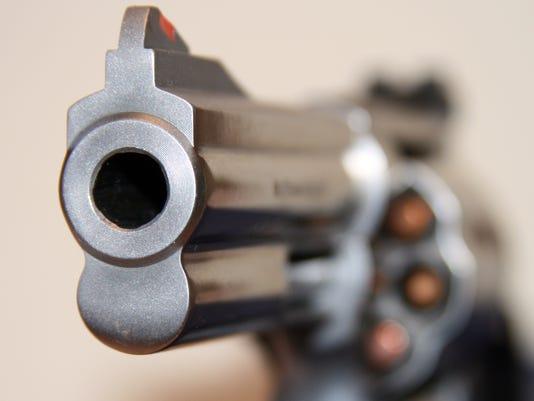 Focus on muzzle of handgun
