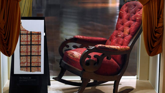 The chair in which President Abraham Lincoln was assassinated on April 14, 1865 is shown on display at the Henry Ford Museum in Dearborn, Mich., March 23, 2015.
