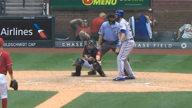 Diamondbacks have another fan change clothes in premium seats.