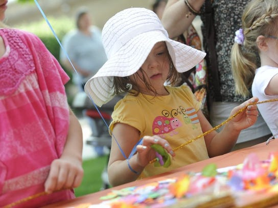 Emma Grace Johnson, 5, of Knoxville, makes a craft